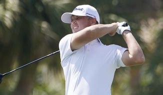 Matt Jones of Australia hits from the 18th tee during the first round of the Honda Classic golf tournament, Thursday, March 18, 2021, in Palm Beach Gardens, Fla. Jones tied the course record at PGA National with a 9-under 61. (AP Photo/Marta Lavandier)