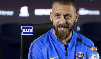 FILE - In this Monday, July. 29, 2019 file photo, Daniele De Rossi speaks during a press conference in Buenos Aires, Argentina. World Cup winner Daniele De Rossi will begin his coaching career this weekend after joining the staff of Italy coach Roberto Mancini on Thursday, March 18, 2021. The Italian Football Association said De Rossi signed a contract on Thursday and will meet with the squad on Sunday at the national team's headquarters in Coverciano for coming World Cup qualifiers against Northern Ireland, Bulgaria and Lithuania. (AP Photo/Tomas F. Cuesta, File)