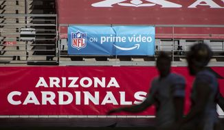 """In this Saturday, Dec. 26, 2020, file photo, An 'NFL on prime video' banner hangs on the field prior to an NFL football game between the San Francisco 49ers and Arizona Cardinals in Glendale, Ariz. The NFL will nearly double its media revenue to more than $10 billion a season with new rights agreements announced Thursday, March 18, 2021 including a deal with Amazon Prime Video that gives the streaming service exclusive rights to """"Thursday Night Football"""" beginning in 2022.(AP Photo/Jennifer Stewart, File) **FILE**"""