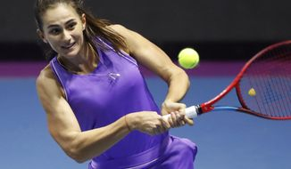 Anastasia Gasanova of Russia returns the ball to Anastasia Pavlyuchenkova of Russia during the St. Petersburg Ladies Trophy-2021 tennis tournament match in St.Petersburg, Russia, Thursday, March 18, 2021. (AP Photo/Dmitri Lovetsky)