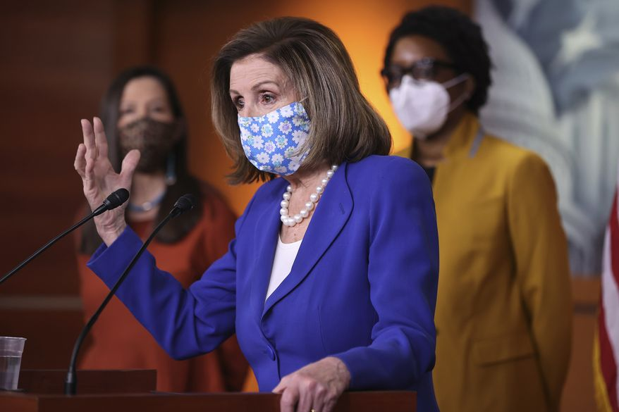 Speaker of the House Nancy Pelosi, D-Calif., speaks during a news conference with Rep. Teresa Leger-Fernandez, D-N.M., left, and Rep. Lauren Underwood, D-Ill., on Capitol Hill in Washington, Friday, March 19, 2021. (Chip Somodevilla/Pool via AP) ** FILE **