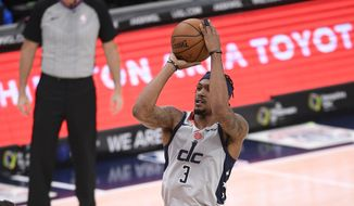 Washington Wizards guard Bradley Beal (3) shoots during the second half of an NBA basketball game against the Utah Jazz, Thursday, March 18, 2021, in Washington. (AP Photo/Nick Wass) **FILE**