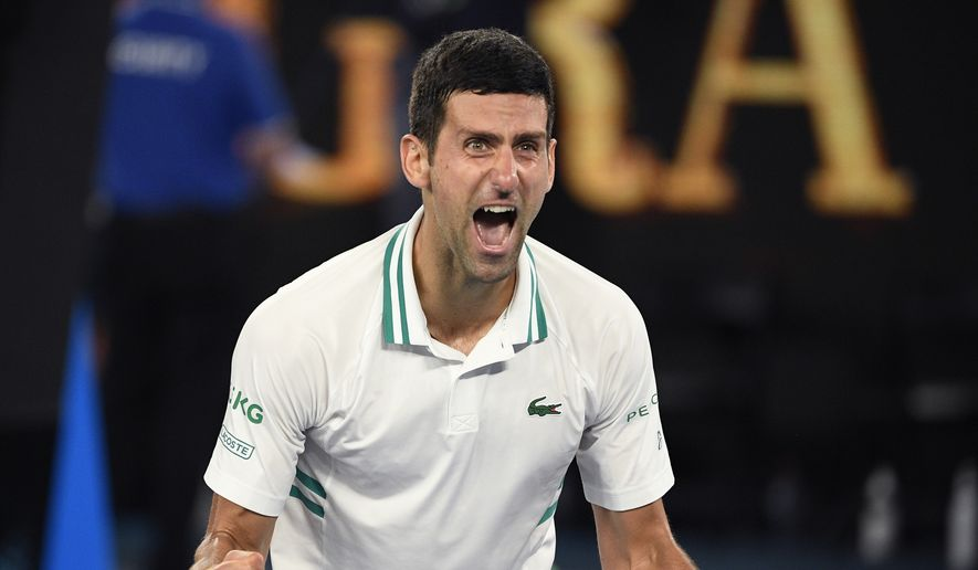 This Feb. 21, 2021, file photo shows Serbia's Novak Djokovic celebrating after defeating Russia's Daniil Medvedev in the men's singles final at the Australian Open tennis championship in Melbourne, Australia. No. 1-ranked Djokovic has pulled out of the upcoming Miami Open, joining Rafael Nadal and Roger Federer on the sideline. Djokovic says that with the current coronavirus restrictions, he needs to find balance in his time on tour and at home. (AP Photo/Andy Brownbill, File)  **FILE**