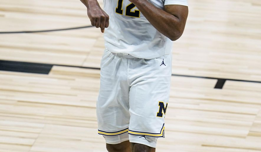 Michigan guard Mike Smith (12) celebrates as Michigan took the lead at halftime in an NCAA college basketball game against Maryland at the Big Ten Conference tournament in Indianapolis, Friday, March 12, 2021. (AP Photo/Michael Conroy)
