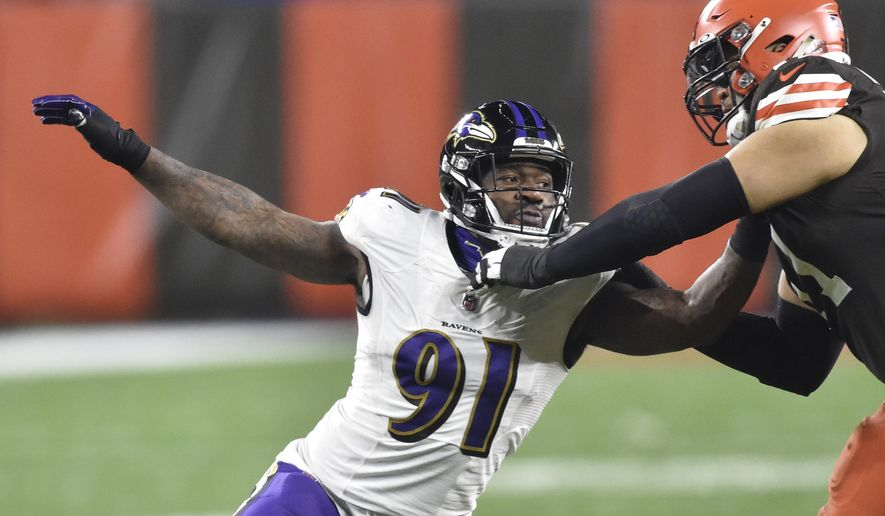 FILE - In this Dec. 14, 2020, file photo, Baltimore Ravens' Yannick Ngakoue (91) rushes the passer during an NFL football game against the Cleveland Browns in Cleveland. The Las Vegas Raiders have agreed to a two-year contract with edge rusher Ngakoue in a deal they hope fills the void created by the Khalil Mack trade in 2018. (AP Photo/David Richard)