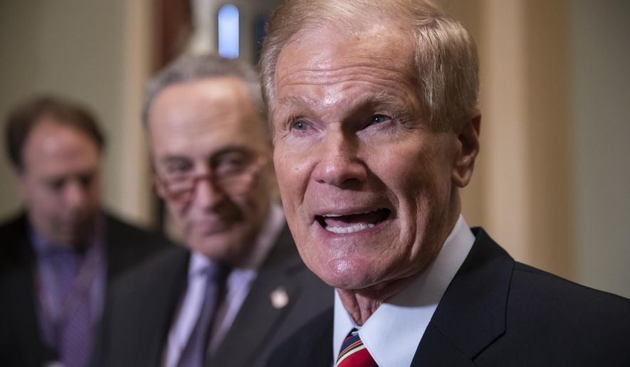 FILE - In this Nov. 13, 2018 file photo, Sen. Bill Nelson, D-Fla., attends a news conference at the Capitol in Washington.  President Joe Biden has chosen Nelson, a former senator from Florida who flew on the space shuttle to lead NASA. Biden announced his intent Friday, March 19, 2021.(AP Photo/J. Scott Applewhite, File)