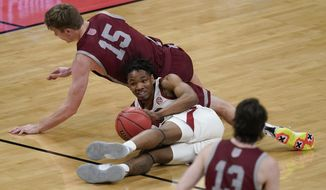 Arkansas' JD Notae (1) and Colgate's Tucker Richardson (15) battle for a loose ball during the first half of a first round game at Bankers Life Fieldhouse in the NCAA men's college basketball tournament, Friday, March 19, 2021, in Indianapolis. (AP Photo/Darron Cummings)