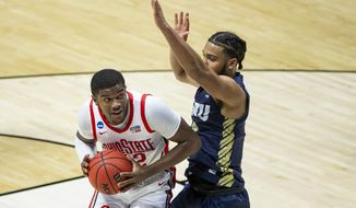 Ohio State's E.J. Liddell, left, gets pressure from Oral Roberts' Kevin Obanor during the first half of a First Round game in the NCAA men's college basketball tournament, Friday, March 19, 2021, at Mackey Arena in West Lafayette, Ind. (AP Photo/Robert Franklin)