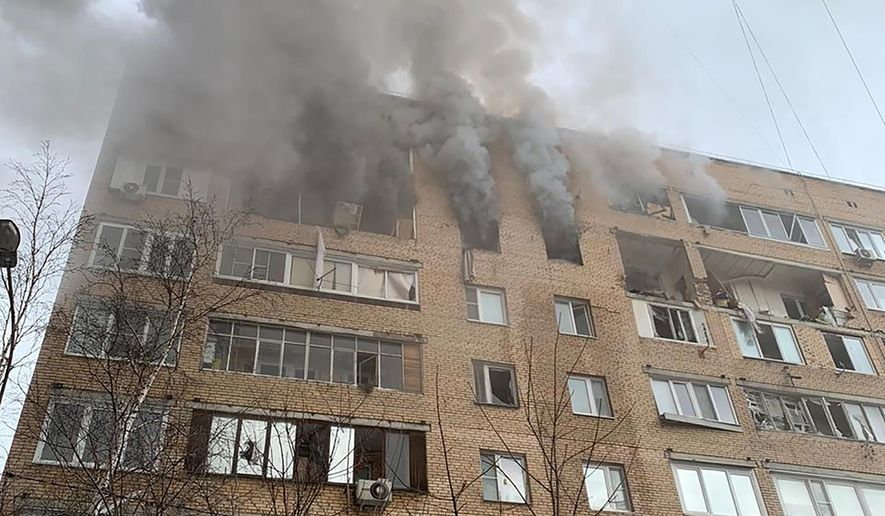 In this photo released by the Russian Emergency Ministry Press Service, smoke pours from an apartment building in Khimki, outside Moscow, Russia, Friday, March 19, 2021. At least one man died after a gas explosion in an apartment building Russian Emergency Situations officials said. (AP Photo/Ministry of Emergency Situations press service via AP)