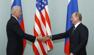 FILE - In this March 10, 2011, file photo, Vice President of the United States Joe Biden, left, shakes hands with Russian Prime Minister Vladimir Putin in Moscow, Russia. The Kremlin said Friday March 19, 2021, that President Vladimir Putin's offer for a quick call with U.S. President Joe Biden was intended to prevent bilateral ties from completely falling apart over Biden's description of the Russian leader as a killer. (AP Photo/Alexander Zemlianichenko, File)