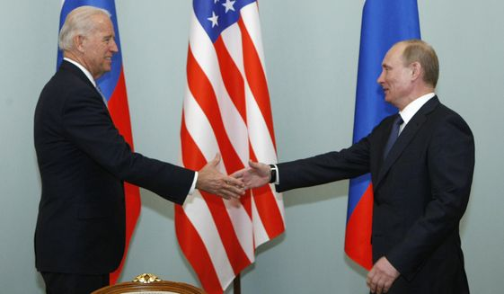 In this March 10, 2011, file photo, then-Vice President of the United States Joe Biden, left, shakes hands with Russian Prime Minister Vladimir Putin in Moscow, Russia. (AP Photo/Alexander Zemlianichenko, File)