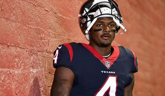 FILE - In this Aug. 25, 2018, file photo, Houston Texans quarterback Deshaun Watson prepares to take the field prior to an NFL preseason football game against the Los Angeles Rams in Los Angeles.  Watson has been sued by four more women who accuse him of sexual assault and harassments. The lawsuits were filed Thursday night, March 18, 2021, hours after the NFL said it was investigating earlier allegations by three massage therapists who said the quarterback sexually assaulted them during massages. (AP Photo/Kelvin Kuo, File)