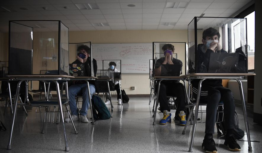 In this March 18, 2021, file photo, students listen to a presentation in a health class in a Connecticut high school. (AP Photo/Jessica Hill, File) **FILE**