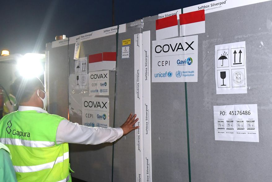 In this March 8, 2021, photo released by Indonesian Presidential Palace, workers unload containers containing AstraZeneca COVID-19 vaccine upon its arrival at Soekarno-Hatta International Airport in Tangerang on the outskirts of Jakarta, Indonesia. Indonesia on Friday, March 19, 2021 cleared the AstraZeneca vaccine for use again after the European Union's drug regulator said the vaccine didn't increase the overall incidence of blood clots. (Indonesian President Palace via AP)