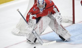 Washington Capitals goaltender Vitek Vanecek (41) in action during the second period of an NHL hockey game against the New York Rangers, Friday, March 19, 2021, in Washington. (AP Photo/Nick Wass)