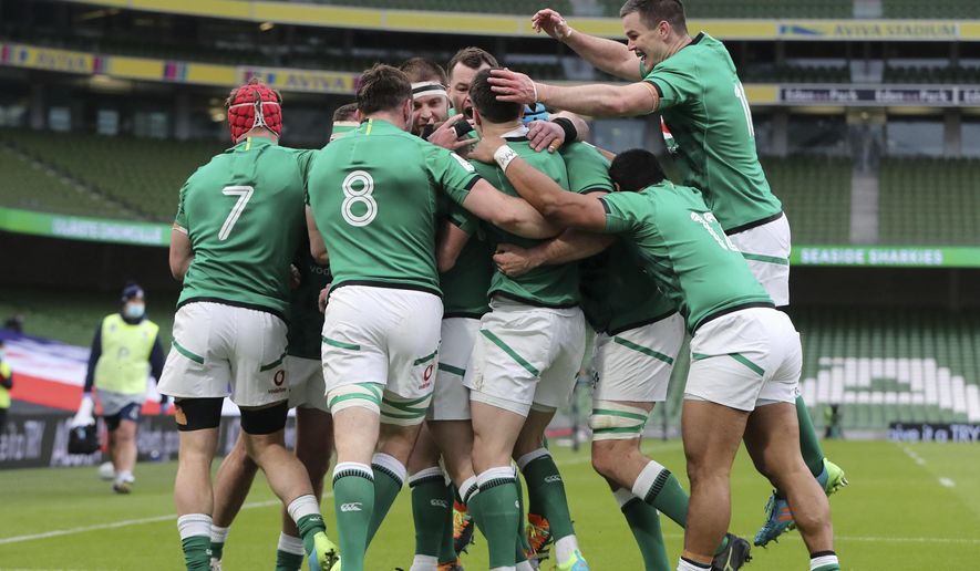 Ireland players celebrate after Keith Earls scores a try during the Six Nations rugby union international between Ireland and England at the Aviva Stadium, Dublin, Saturday March 20, 2021. (Niall Carson/Pool via AP)