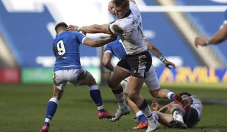 Scotland's Duhan van der Merwe, right, is tackled by Italy's Stephen Varney during the rugby union international match between Scotland and Italy at the Murrayfield stadium in Edinburgh, Scotland, Saturday, March 20, 2021. (AP Photo/Scott Heppell)