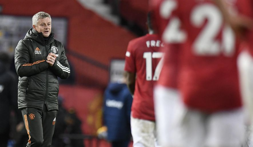 Manchester United's manager Ole Gunnar Solskjaer reacts following the English Premier League soccer match between Manchester United and West Ham United at Old Trafford, Manchester, England, Sunday, March. 14, 2021. (AP Photo/Peter Powell,Pool)