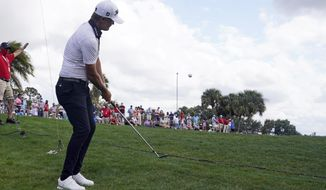 Matt Jones, of Australia, hits from the rough on the sixth hole during the third round of the Honda Classic golf tournament, Saturday, March 20, 2021, in Palm Beach Gardens, Fla. (AP Photo/Marta Lavandier)