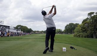 Phil Mickelson hits from the 11th tee during the third round of the Honda Classic golf tournament, Saturday, March 20, 2021, in Palm Beach Gardens, Fla. (AP Photo/Marta Lavandier)