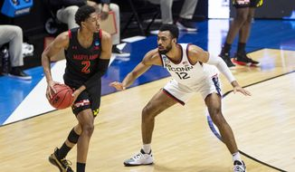 Maryland's Aaron Wiggins (2) looks to pass around Connecticut's Tyler Polley (12) during the second half of a first-round game in the NCAA men's college basketball tournament,Saturday, March 20, 2021, at Mackey Arena in West Lafayette, Ind. Maryland won 63-54. (AP Photo/Robert Franklin) **FILE**