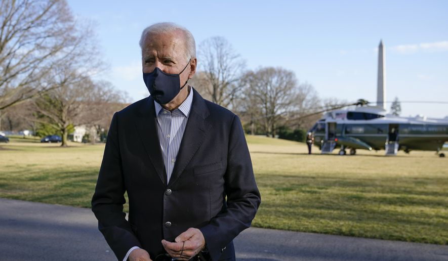 President Joe Biden walks on the South Lawn of the White House in Washington, Sunday, March 21, 2021, after stepping off Marine One. Biden is returning to Washington after spending the weekend at Camp David. (AP Photo/Patrick Semansky)