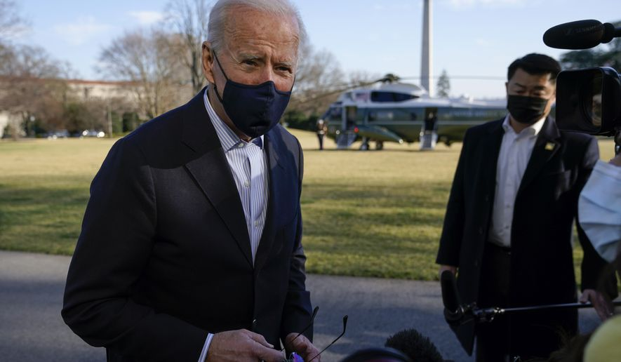President Joe Biden speaks with members of the press on the South Lawn of the White House in Washington, Sunday, March 21, 2021, after stepping off Marine One. Biden is returning to Washington after spending the weekend at Camp David. (AP Photo/Patrick Semansky)