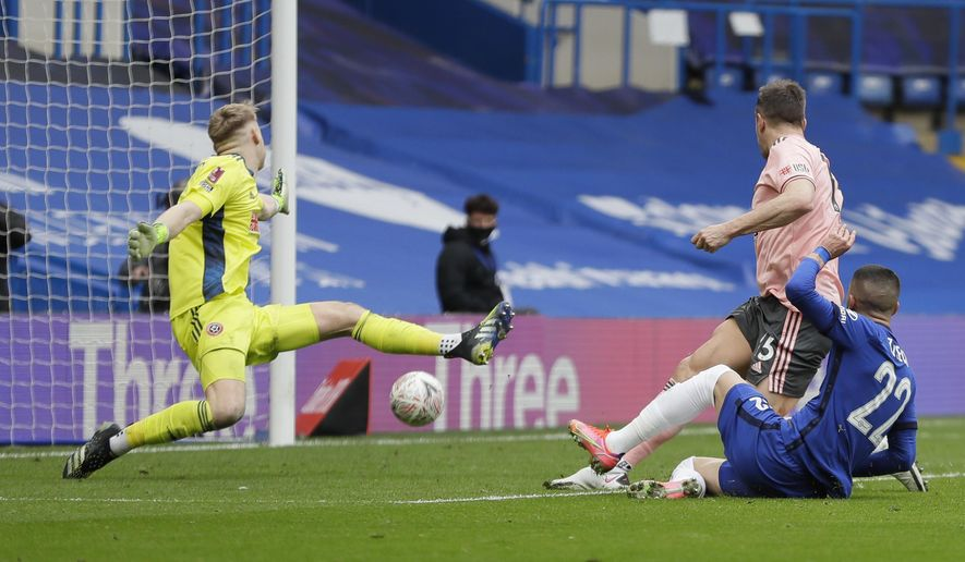 Chelsea's Hakim Ziyech, right, scores his side's second goal during the English FA Cup quarterfinal soccer match between Chelsea and Sheffield United at the Stamford Bridge stadium in London, Sunday, March 21, 2021. (AP Photo/Kirsty Wigglesworth)