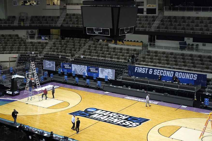 The Indiana Farmers Coliseum scoreboard goes dark after a first round NCAA college basketball tournament game between Iowa and Grand Canyon Saturday, March 20, 2021, in Indianapolis. The VCU Oregon game scheduled to be played after the Iowa Grand Canyon game was cancelled after VCU was pulled from the NCAA Tournament because of COVID-19 protocols. The NCAA says the 10th-seeded Rams' first-round game Saturday against Oregon has been declared a no-contest. (AP Photo/Charles Rex Arbogast)