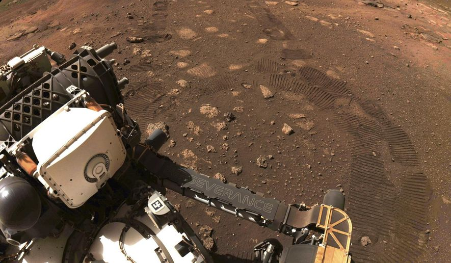 FILE - This March 4, 2021 file photo made available by NASA was taken during the first drive of the Perseverance rover on Mars. The Perseverance rover has been on Mars for a month, collecting data and making discoveries with each passing day. A number of the findings, through a collaboration with NASA, have been catalogued in Diné Bizaad, the Navajo language. (NASA/JPL-Caltech via AP, File)