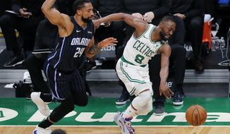 Orlando Magic's Khem Birch (24) fouls Boston Celtics' Kemba Walker (8) during the first half on an NBA basketball game, Sunday, March 21, 2021, in Boston. (AP Photo/Michael Dwyer)