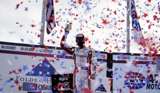 Ryan Blaney celebrates his win after a NASCAR Cup Series auto race at Atlanta Motor Speedway on Sunday, March 21, 2021, in Hampton, Ga. (AP Photo/Brynn Anderson)