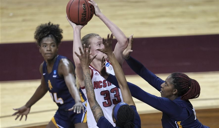 North Carolina State's Elissa Cunane (33) tries to shoot against North Carolina A&T players during the first half of a college basketball game in the first round of the women's NCAA tournament at the University Events Center in San Marcos, Texas, Sunday, March 21, 2021. (AP Photo/Chuck Burton)