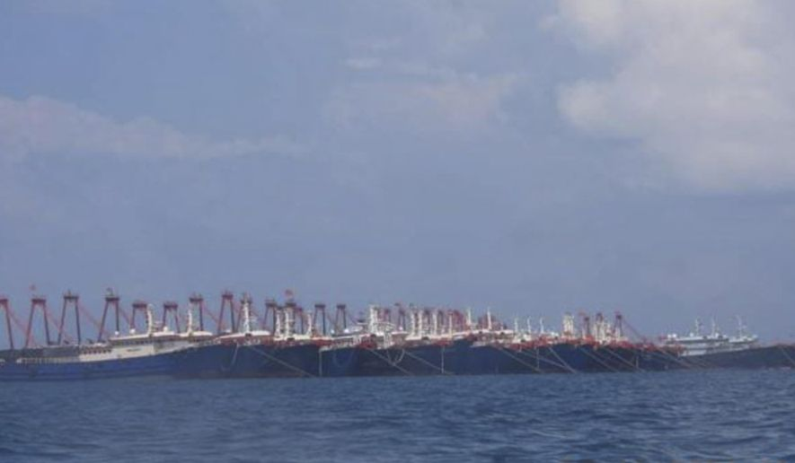 In this photo provided Sunday, March 21, 2021, by the Philippine Coast Guard/National Task Force-West Philippine Sea, some of the 220 Chinese vessels are seen moored at Whitsun Reef, South China Sea on March 7, 2021. The Philippine government expressed concern after spotting more than 200 Chinese fishing vessels it believed were crewed by militias at a reef claimed by both countries in the South China Sea, but it did not immediately lodge a protest. (Philippine Coast Guard/National Task Force-West Philippine Sea via AP)