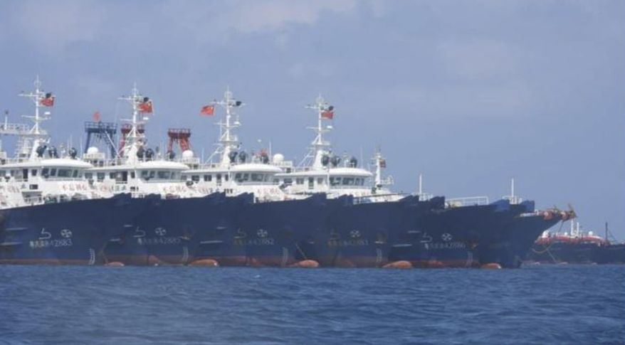 In this March 7, 2021, photo provided by the Philippine Coast Guard/National Task Force-West Philippine Sea, some of the 220 Chinese vessels are seen moored at Whitsun Reef, South China Sea. The Philippine government expressed concern after spotting more than 200 Chinese fishing vessels it believed were crewed by militias at a reef claimed by both countries in the South China Sea, but it did not immediately lodge a protest. (Philippine Coast Guard/National Task Force-West Philippine Sea via AP)