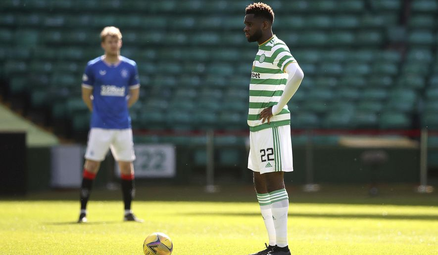 Celtic's Odsonne Edouard stands instead of taking a knee prior to the Scottish Premiership soccer match at Celtic Park, Glasgow, Sunday March 21, 2021. Glasgow's rival soccer teams stood rather than taking a knee in a pre-match solidarity before the derby at Celtic after Rangers midfielder Glen Kamara faced racial abuse in a European match.(Andrew Milligan/PA via AP)