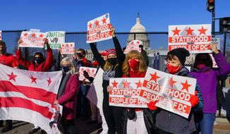 Advocates for statehood for the District of Columbia rally near the Capitol prior to a hearing on creating a 51st state on Monday. (Associated Press)