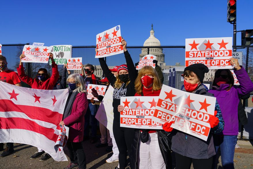 Advocates for statehood for the District of Columbia rally near the Capitol prior to a House of Representatives hearing on creating a 51 state, in Washington, Monday, March 22, 2021. (Associated Press) **FILE**