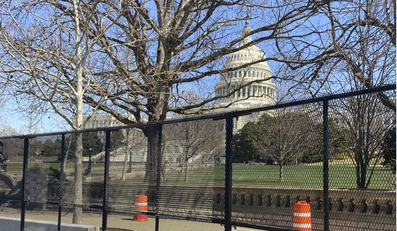 The U.S. Capitol is shown behind security fencing, Sunday, March 21, 2021, in Washington. (AP Photo/Alan Fram)  **FILE**