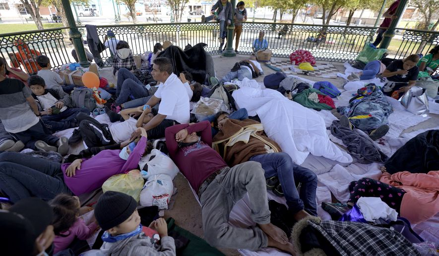 A group of migrants rest on a gazebo at a park after they were expelled from the U.S. and pushed by Mexican authorities off an area where they had been staying, Saturday, March 20, 2021, in Reynosa, Mexico. The fate of thousands of migrant families who have recently arrived at the Mexico border is being decided by a mysterious new system under President Joe Biden. U.S. authorities are releasing migrants with acute vulnerabilities and allowing them to pursue asylum. But it's not clear why some are considered vulnerable and not others. (AP Photo/Julio Cortez)
