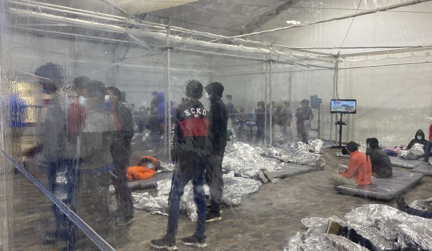 This March 20, 2021, photo provided by the Office of Congressman Henry Cuellar, (TX-28), shows detainees in a Customs and Border Protection (CBP) temporary overflow facility in Donna, Texas. President Joe Biden's administration faces mounting criticism for refusing to allow outside observers into facilities where it is detaining thousands of immigrant children. (Photo courtesy of the Office of Congressman Henry Cuellar via AP)
