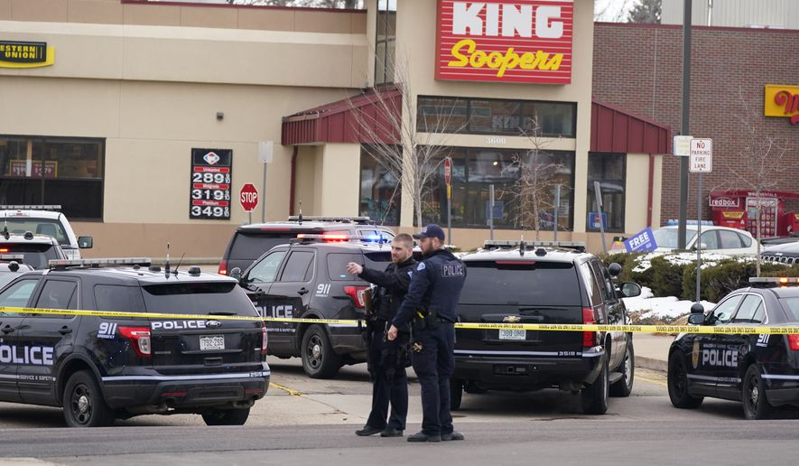 Police work on the scene outside of a King Soopers grocery store where a shooting took place Monday, March 22, 2021, in Boulder, Colo. (AP Photo/David Zalubowski)
