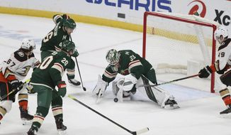 Minnesota Wild's goalie Cam Talbot (33) stops the puck against the Anaheim Ducks during the first period of an NHL hockey game Monday, March 22, 2021, in St. Paul, Minn. (AP Photo/Stacy Bengs)