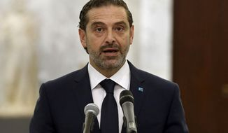 In this photo released by Lebanese government, Lebanese Prime Minister-Designate Saad Hariri, speaks to journalists after his meeting with Lebanese President Michel Aoun, at the Presidential Palace in Baabda, east of Beirut, Lebanon, Monday, March. 22, 2021. Talks on the formation of a new Cabinet in Lebanon collapsed Monday, heralding more economic and financial collapse for the small Arab country. (Dalati Nohra/Lebanese Official Government via AP)