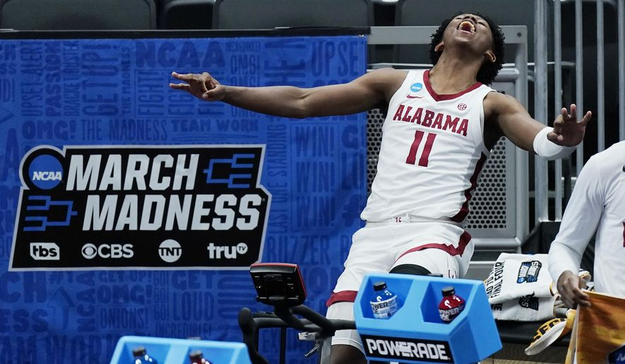 Alabama's Joshua Primo celebrates a teammate's score against Maryland during the second half of a college basketball game in the second round of the NCAA tournament at Bankers Life Fieldhouse in Indianapolis Monday, March 22, 2021. (AP Photo/Mark Humphrey)