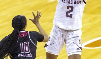 Texas A&M guard Aaliyah Wilson (2) shoots over Troy guard Janiah Sandifer (10) during the second half of a college basketball game in the first round of the women's NCAA tournament at the Frank Erwin Center in Austin, Texas, Monday, March 22, 2021. (AP Photo/Stephen Spillman)