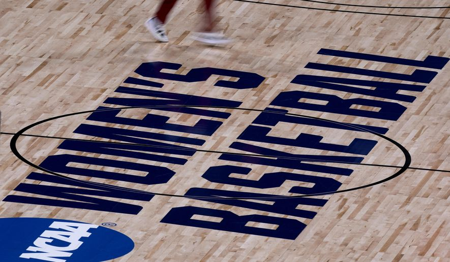 A Stanford player warms up before a college basketball game against Utah Valley in the first round of the women's NCAA tournament at the Alamodome in San Antonio, Sunday, March 21, 2021. (AP Photo/Charlie Riedel)