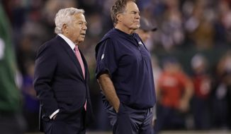 FILE - New England Patriots owner Robert Kraft, left, talks to head coach Bill Belichick as their team warms up before an NFL football game against the New York Jets in East Rutherford, N.J., in this Monday, Oct. 21, 2019, file photo. Belichick never was one to spent wildly in free agency. But after watching Tom Brady celebrate another Super Bowl in another city, Belichick and his boss, Robert Kraft, had seen enough.  (AP Photo/Adam Hunger, File)