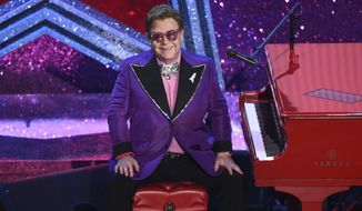 "In this Sunday, Feb. 9, 2020, file photo, Elton John appears after performing his nominated song, ""(I'm Gonna) Love Me Again,"" at the Oscars in Los Angeles. (AP Photo/Chris Pizzello, File)"