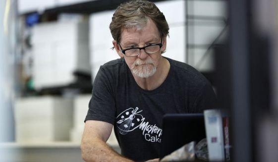 In this Monday, June 4, 2018, file photograph, baker Jack Phillips, owner of Masterpiece Cakeshop, manages his shop in Lakewood, Colo. Baker, who refused to make a wedding cake for a gay couple in 2012 is being sued by a lawyer for declining to make a cake celebrating her gender transition. The U.S. Supreme Court ruled in 2018 the commission showed anti-religious bias when it sanctioned Phillips. The justices did not rule on the larger issue of whether businesses can invoke religious objections to refuse service to gays or lesbians. (AP Photo/David Zalubowski, File)